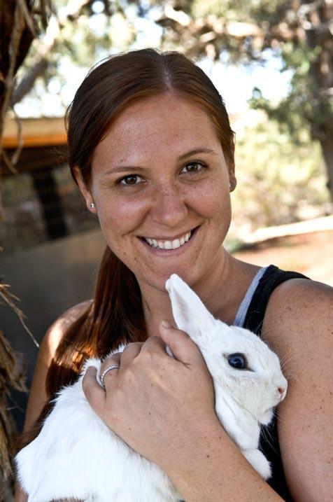 Jamie Noe, co-founder of Hug-a-Bunny, holding a rabbit