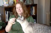 Cheryl Collins with a feline friend