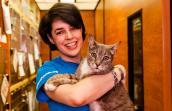 Volunteer Stephanie Etherton holding Rosalinda the cat